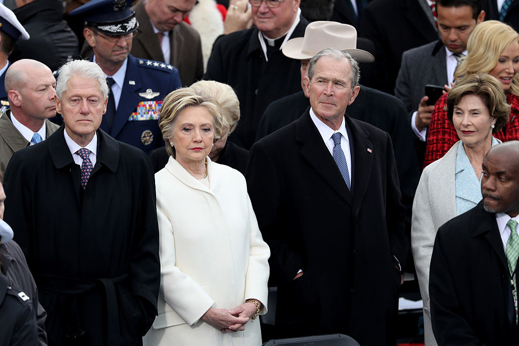 Bill Clinton, Hilary Clinton, George W. Bush, and Laura Bush looking on at the inauguration