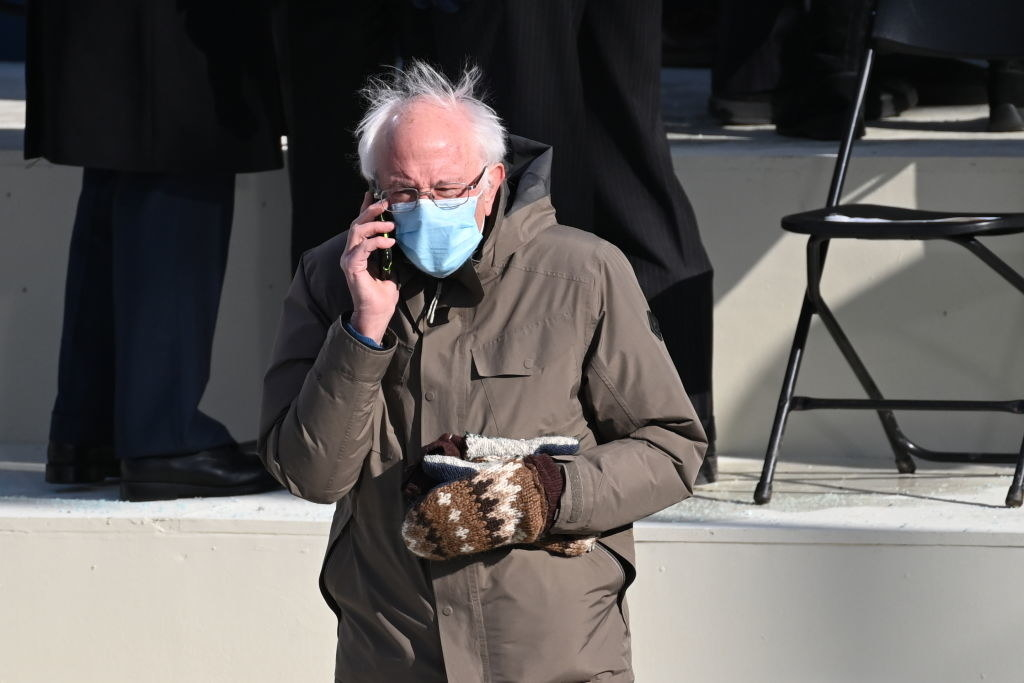 Bernie Sanders speaking on his cellphone at the inauguration
