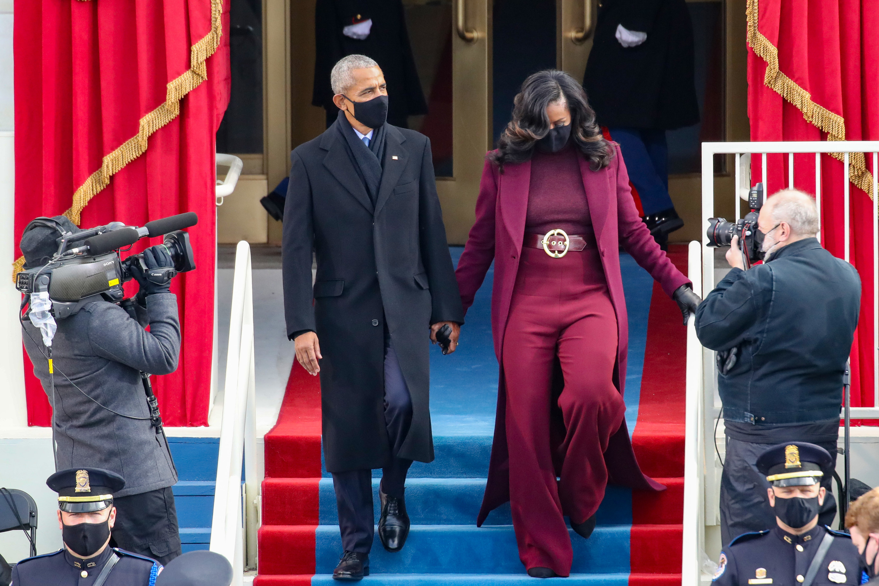 Former U.S. President Barack Obama and former first lady Michelle Obama in black face masks arriving at the inauguration.