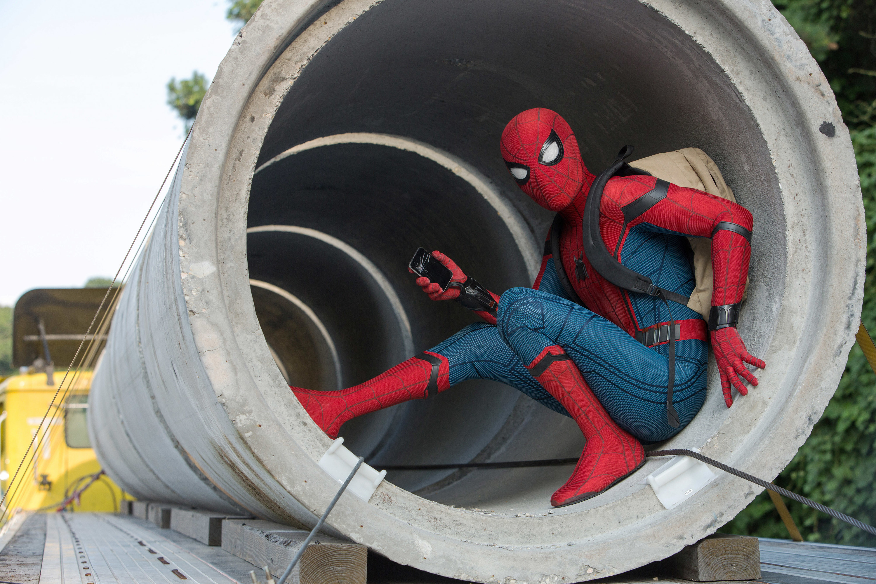 Spider-Man hiding in a large industrial pipe