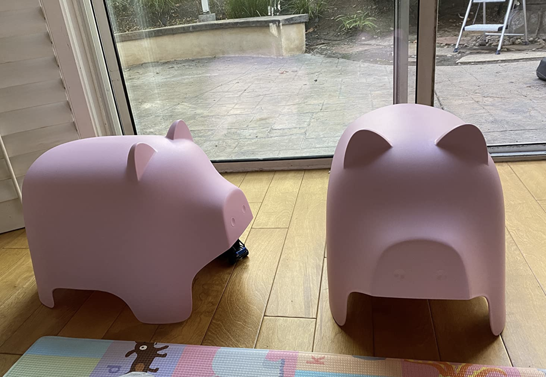 reviewer photo of two stackable pig chairs