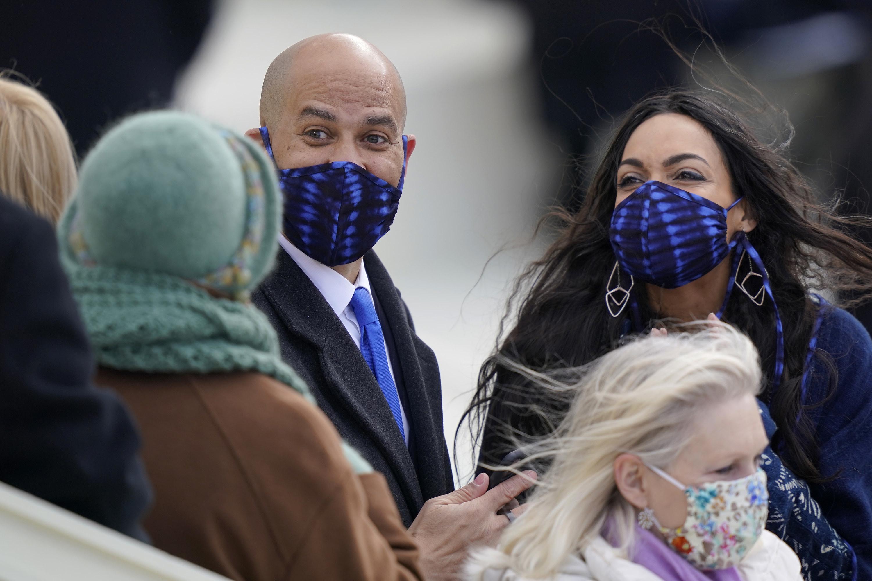 Sen. Cory Booker and Rosario Dawson in indigo-dyed face masks at the inauguration.
