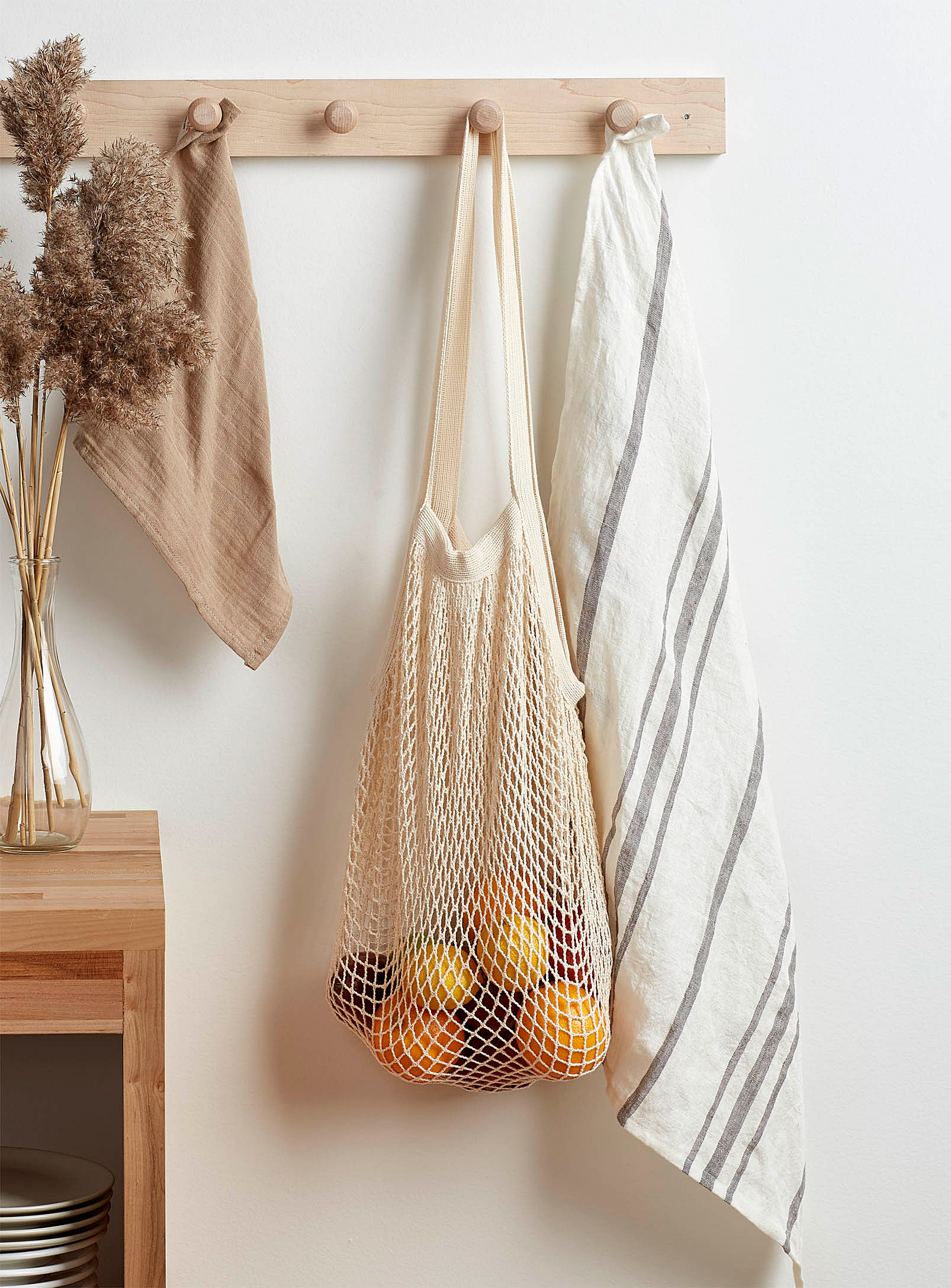 mesh bag hanging with fruit in it