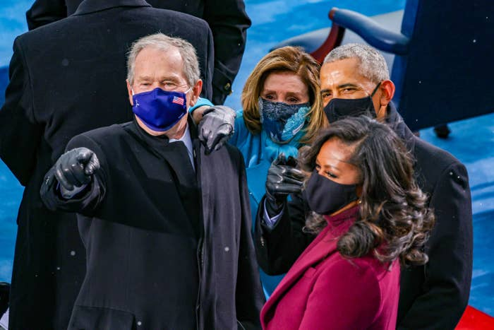 George W. Bush in a blue face mask with an American flag, Nancy Pelosi in a blue floral face mask, Barack Obama and Michelle Obama in black face masks at the inauguration of U.S. President-elect Joe Biden.