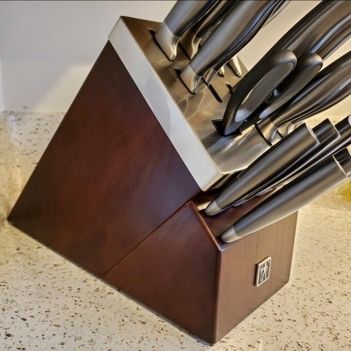 a set of kitchen knives in a wooden block