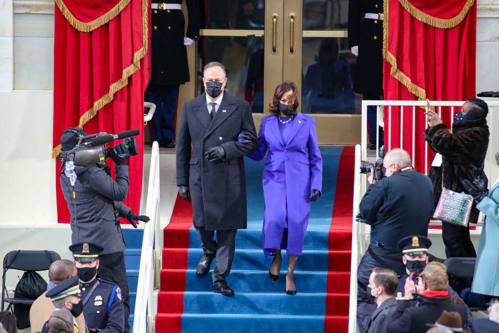 Vice President Kamala Harris and Second Gentleman Doug Emhoff descending the Capitol steps