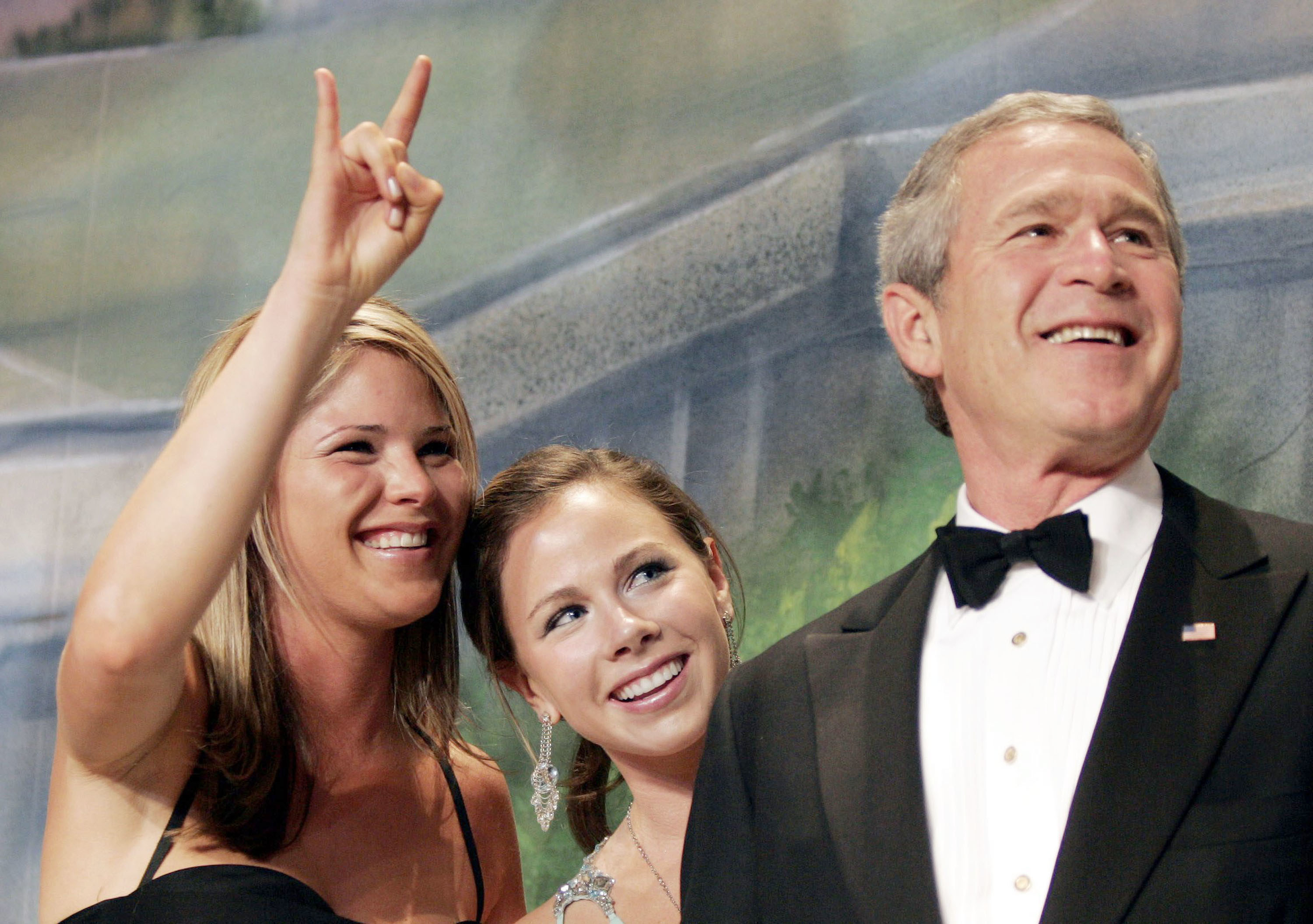 """One of the Bush twins makes a """"devil horns"""" symbol with one hand"""