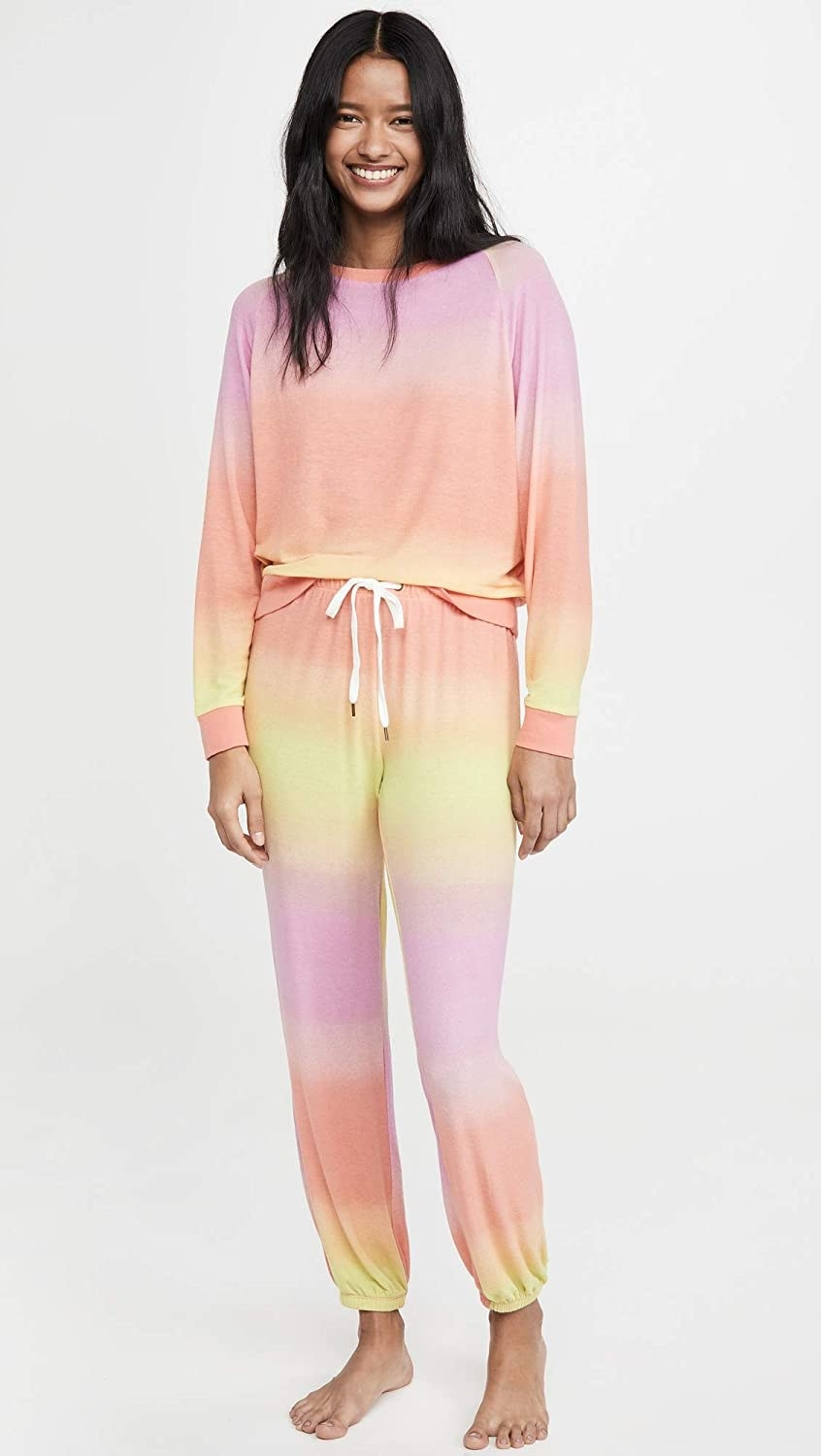 The peach, pink, and yellow sweatshirt and pants set