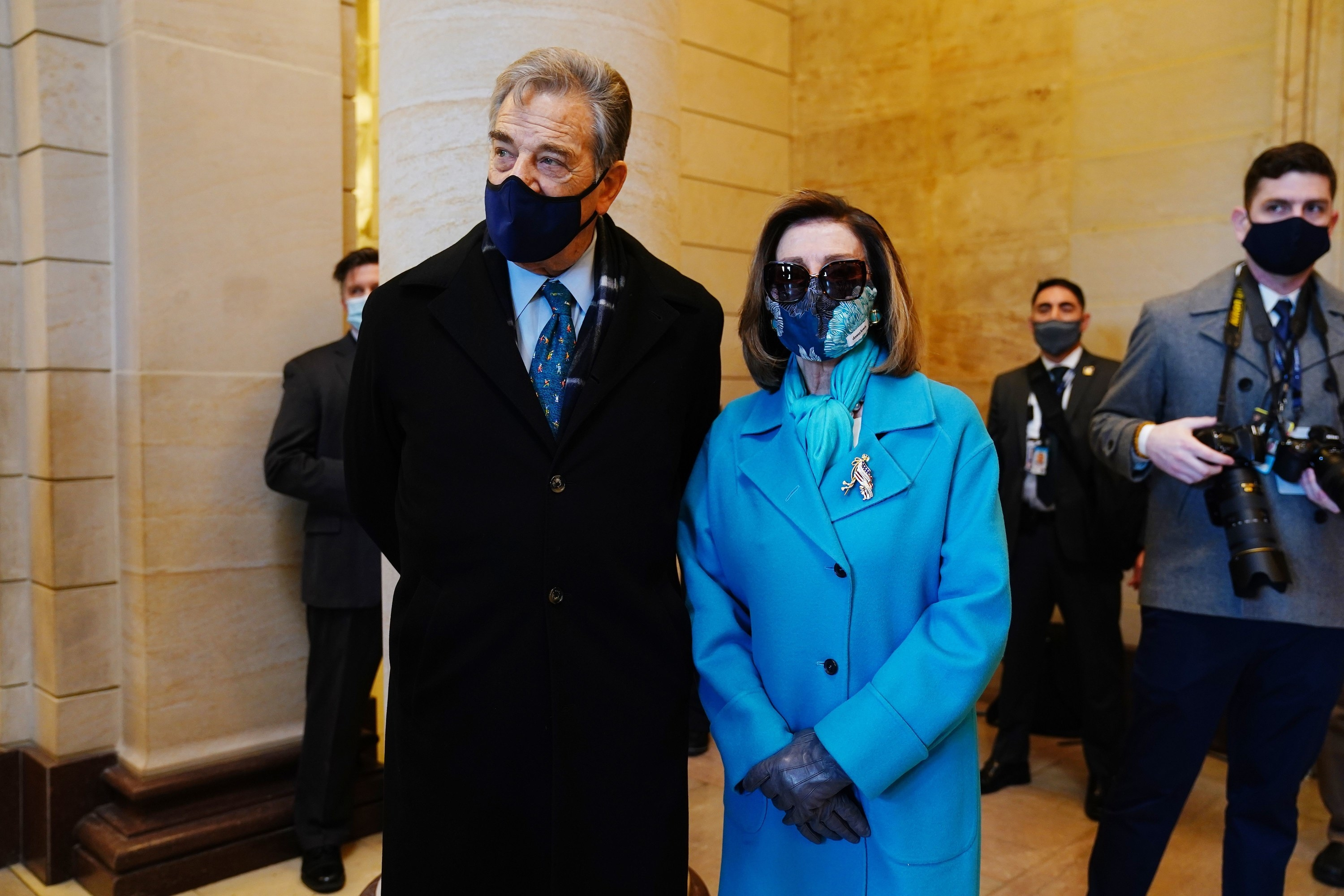 Nancy Pelosi in a blue floral face mask and her husband Paul in a navy face mask at the inauguration.
