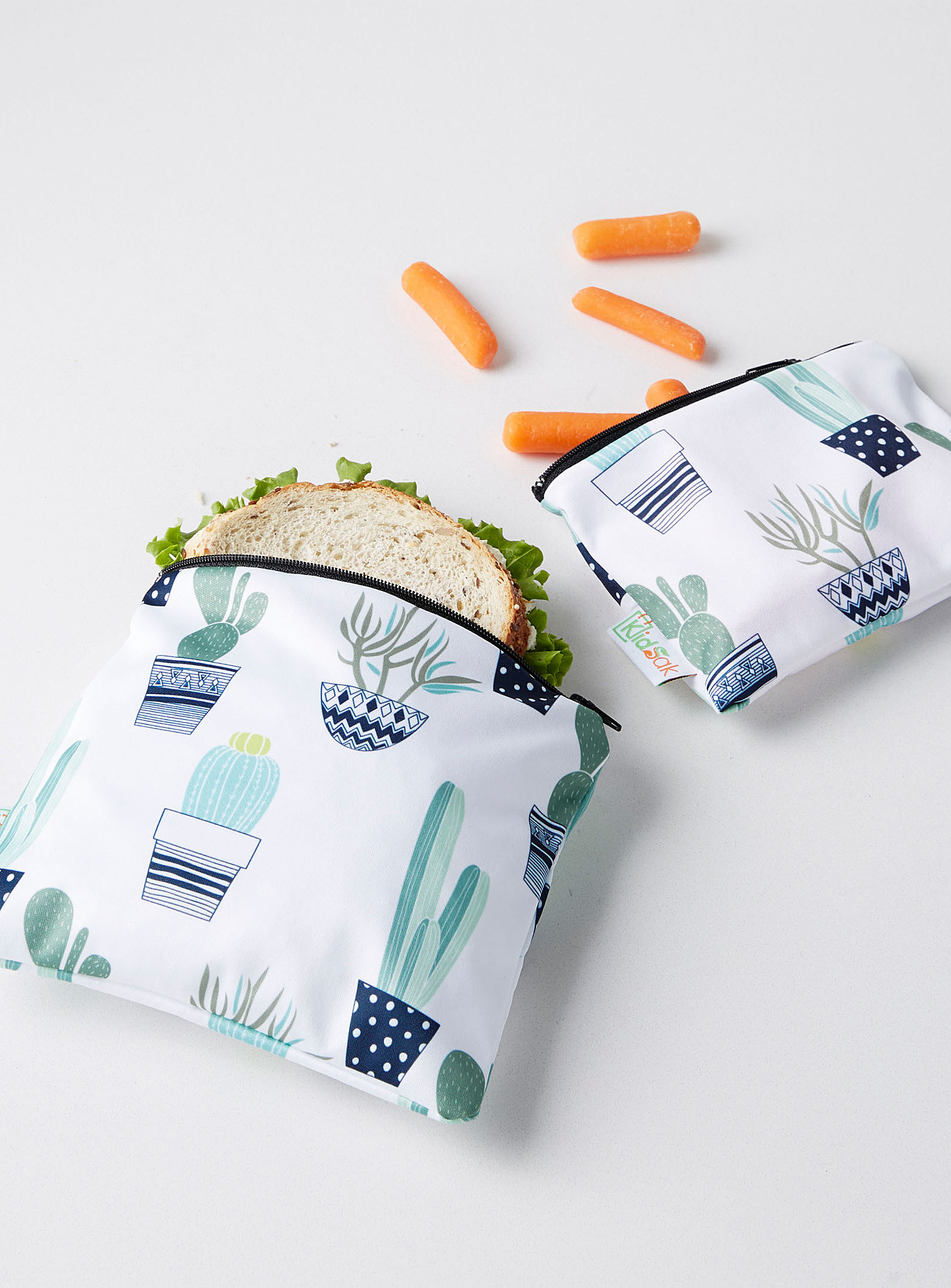 the cactus printed bags with a sandwich and carrot sticks inside them