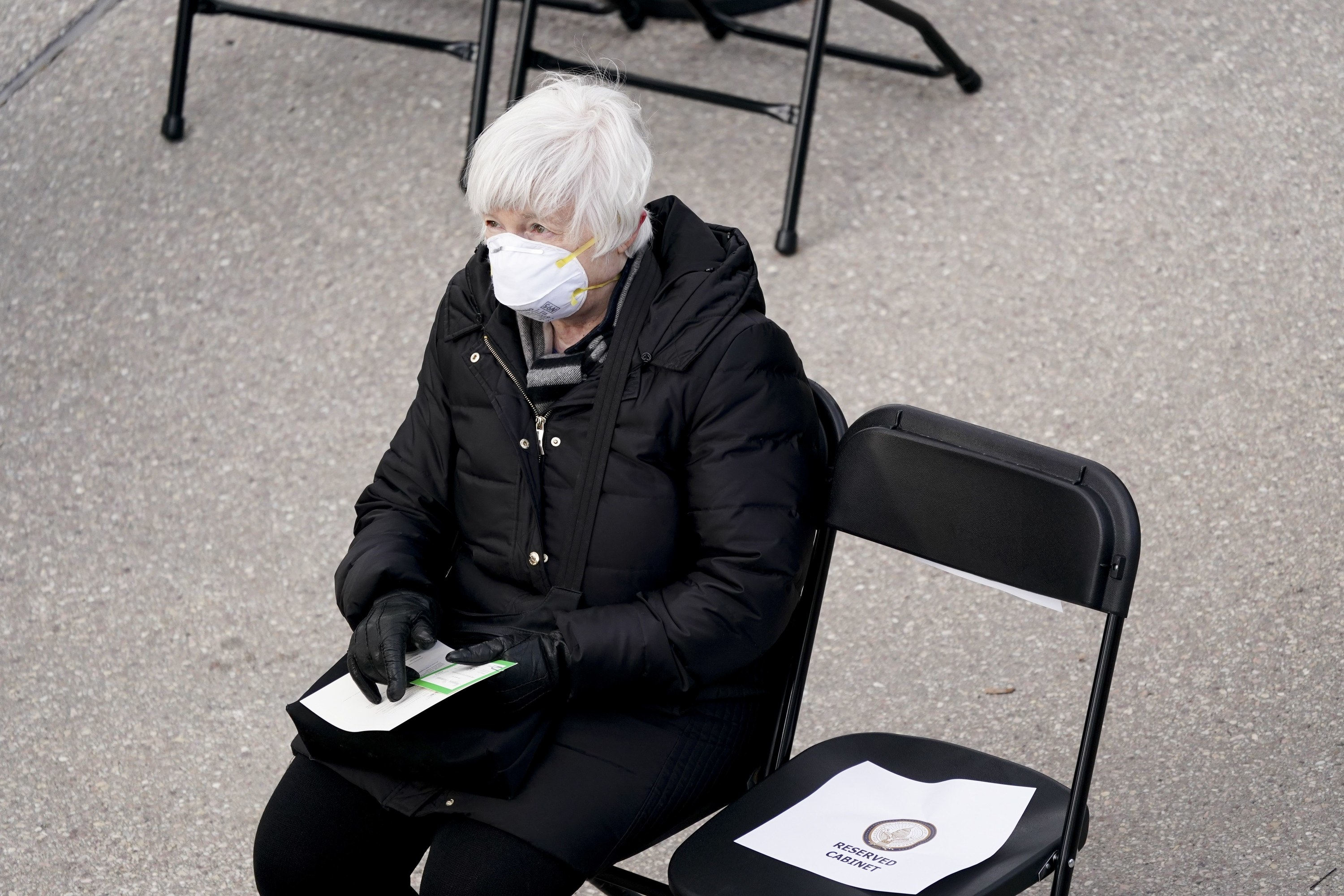 Janet Yellen, seated in an N-95 mask and black jacket, at the inaguration.