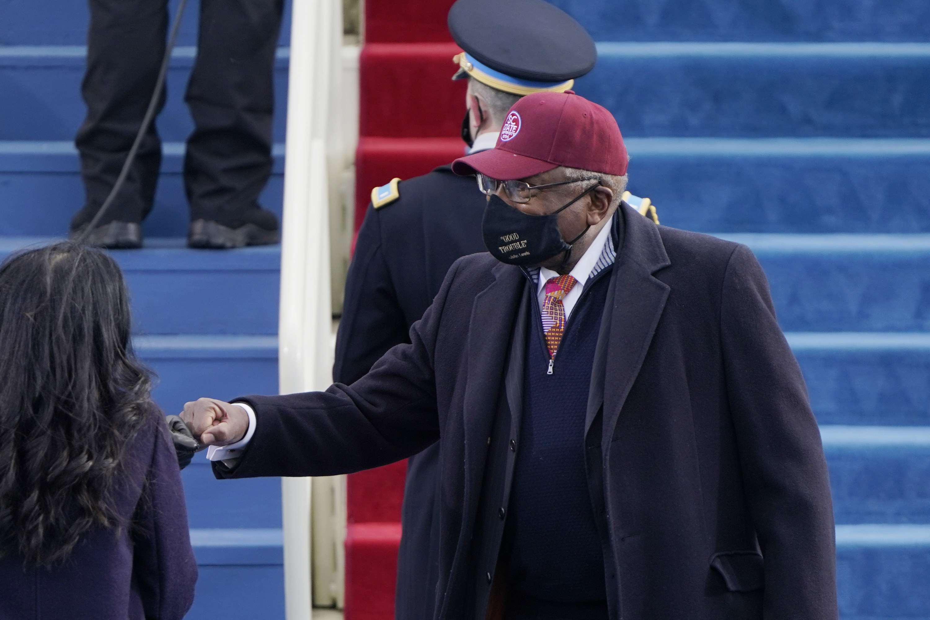 """House Majority Whip James Clyburn wearing a black mask with """"Good Trouble"""" printed on it at the inauguration."""