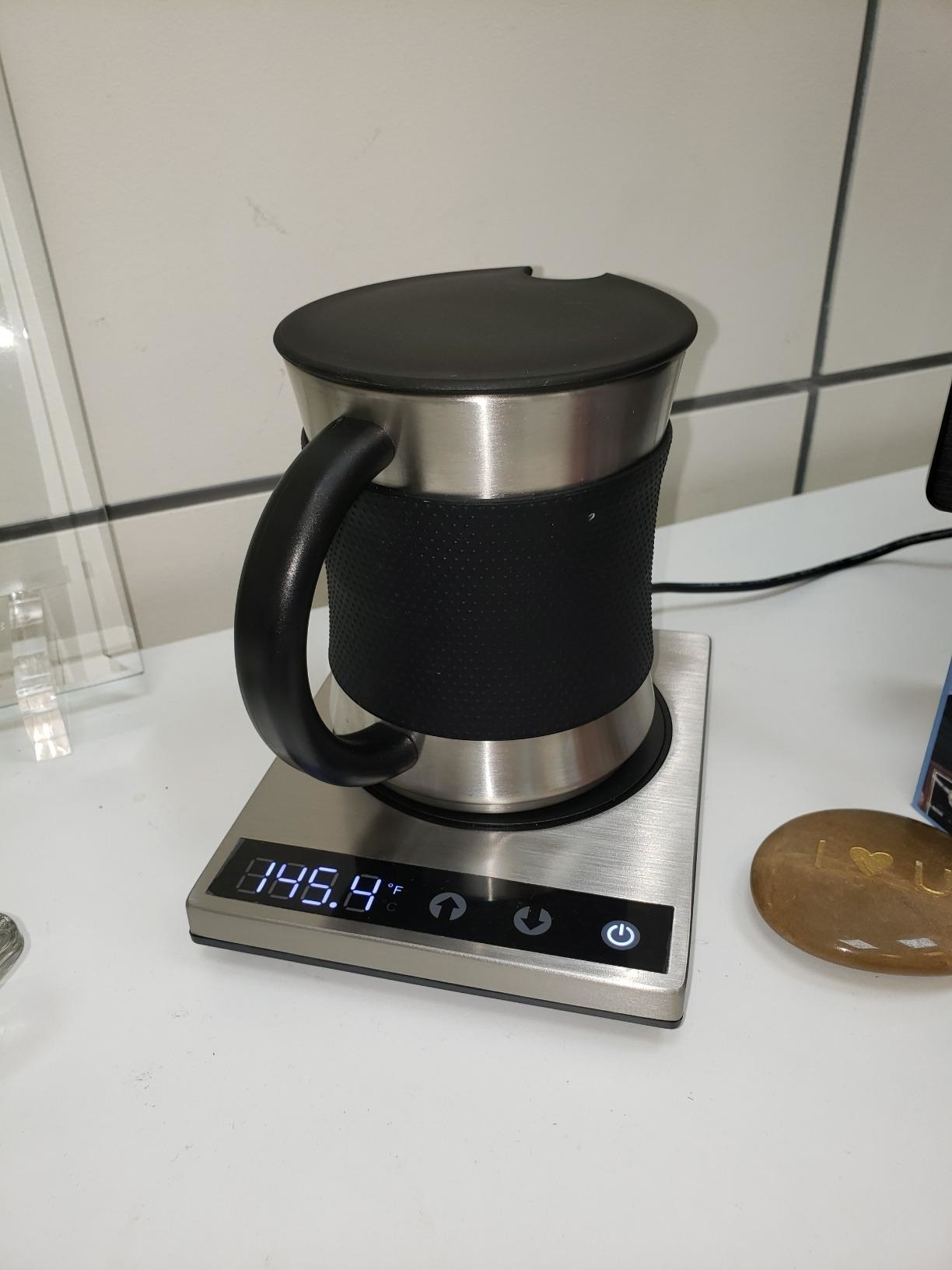 Reviewer photo of mug warmer with included mug placed on countertop