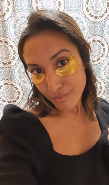 buzzfeed writer with gold eye masks on