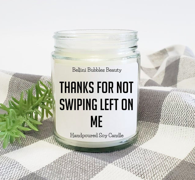 "A jar candle with a label that says ""thanks for not swiping left on me"""