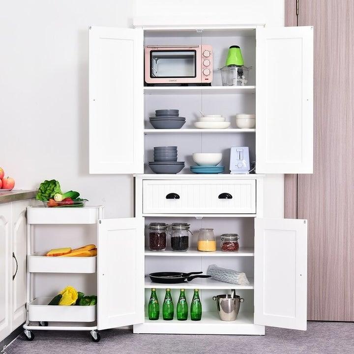 an open kitchen pantry exposing six shelves behind the doors