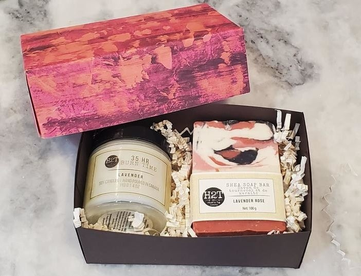 A bar of soap and a candle in a gift box