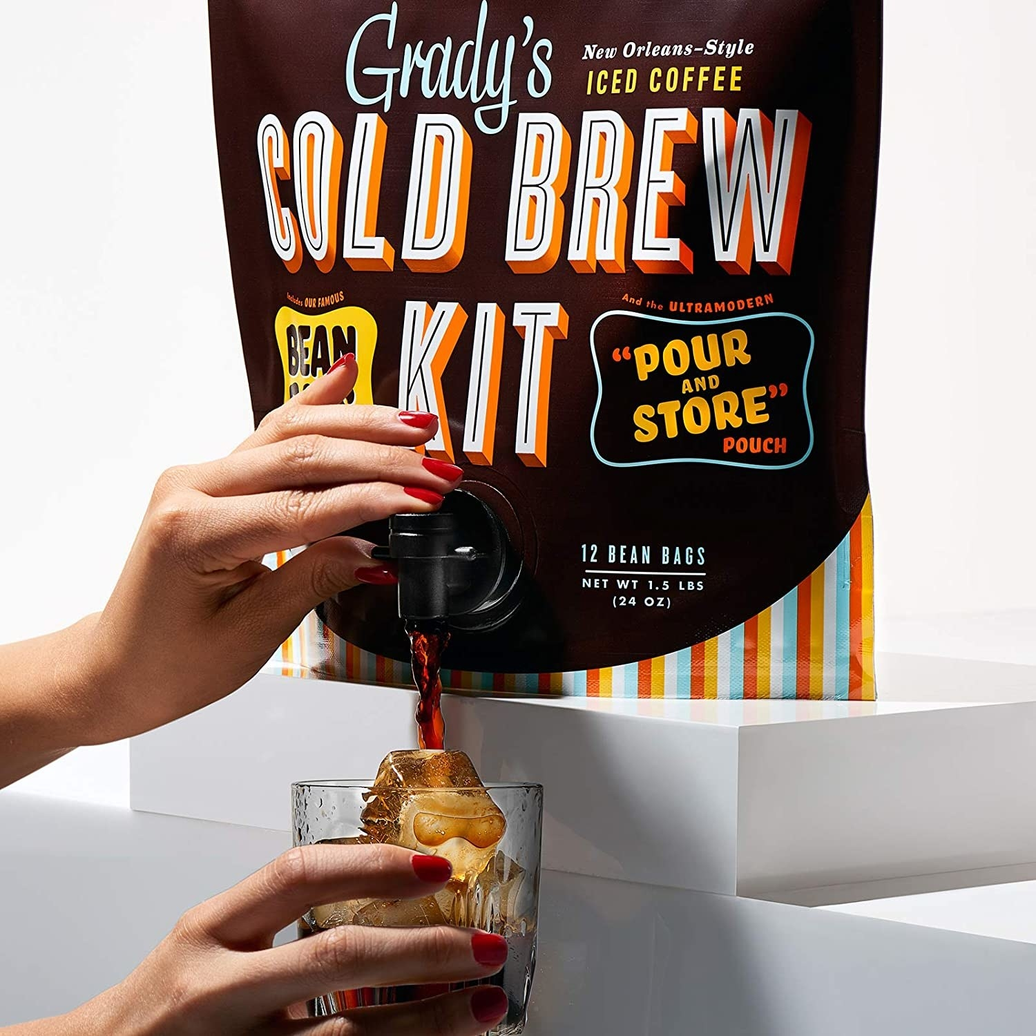 Model pouring cold brew from Grady's cold brew bag