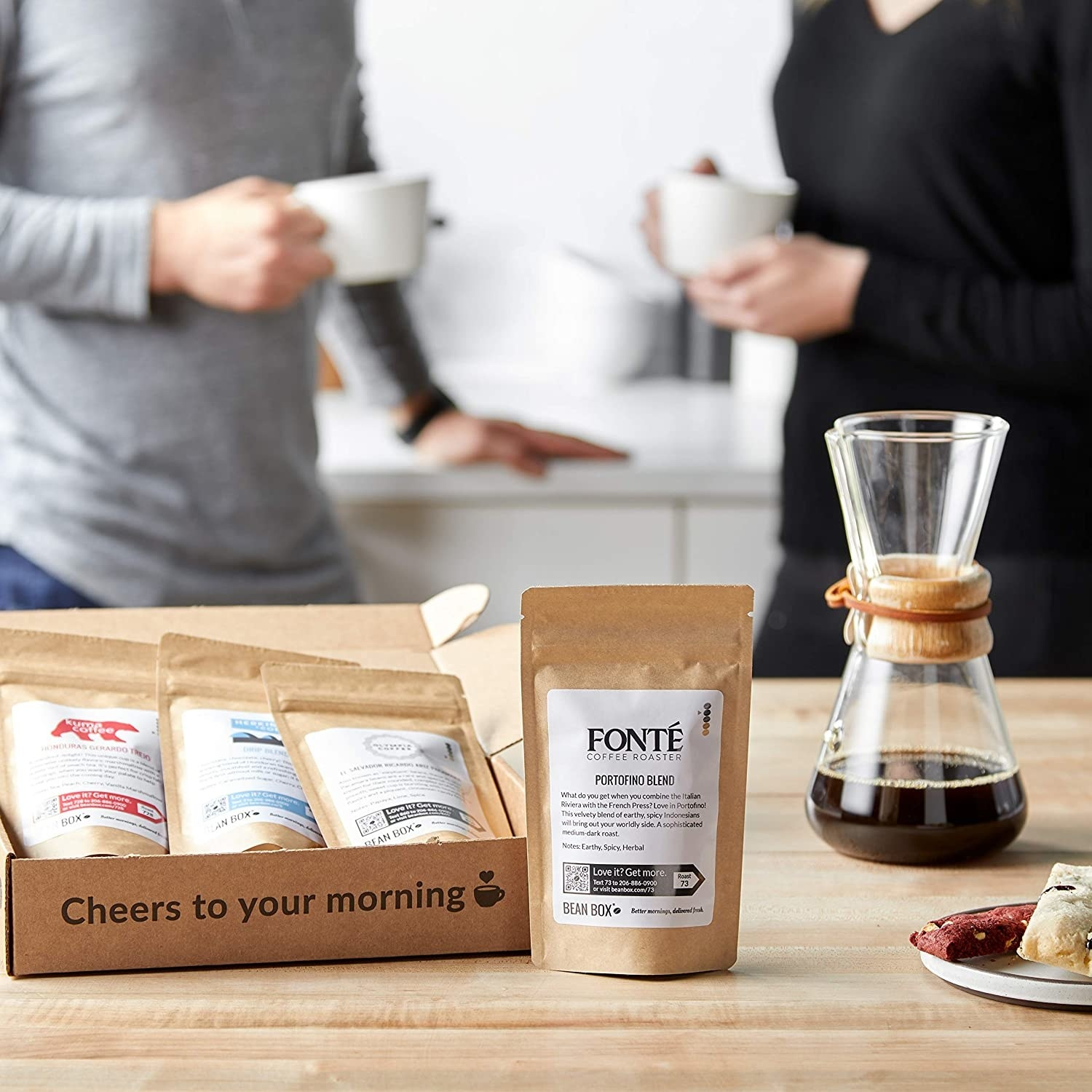 Four bags of coffee from gift box placed on kitchen counter