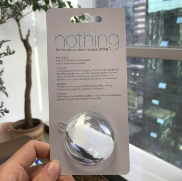 "A person holding up a package that says ""nothing"""