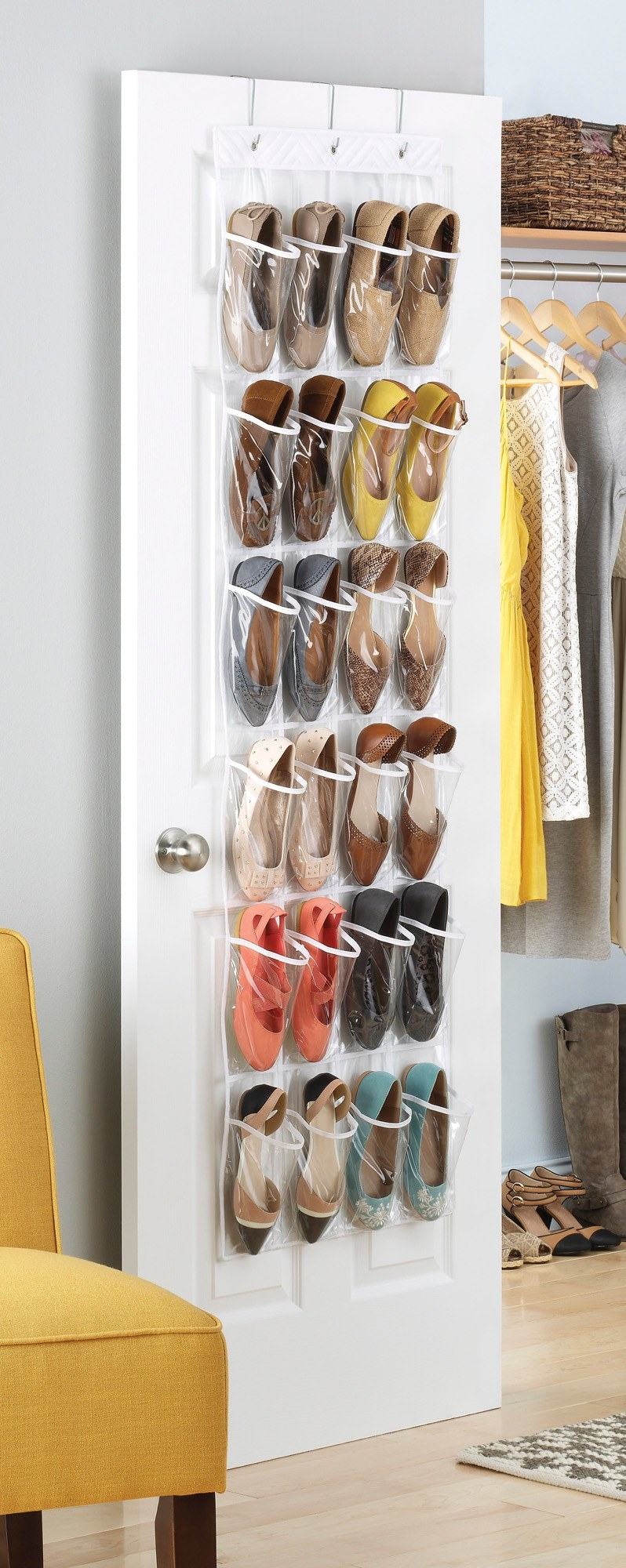The shoe organizer hanging over a closet door, filled with 12 pairs of shoes