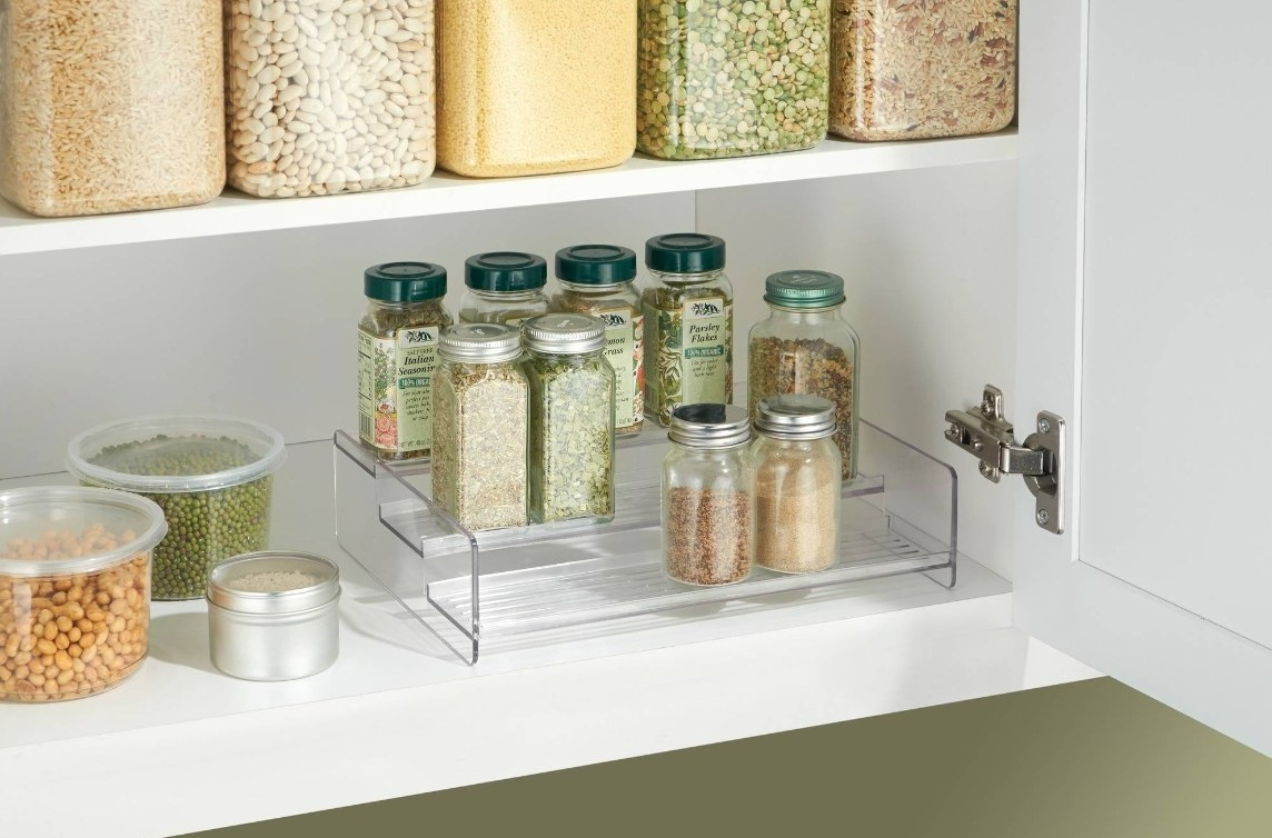 The three-tier spice rack in clear plastic