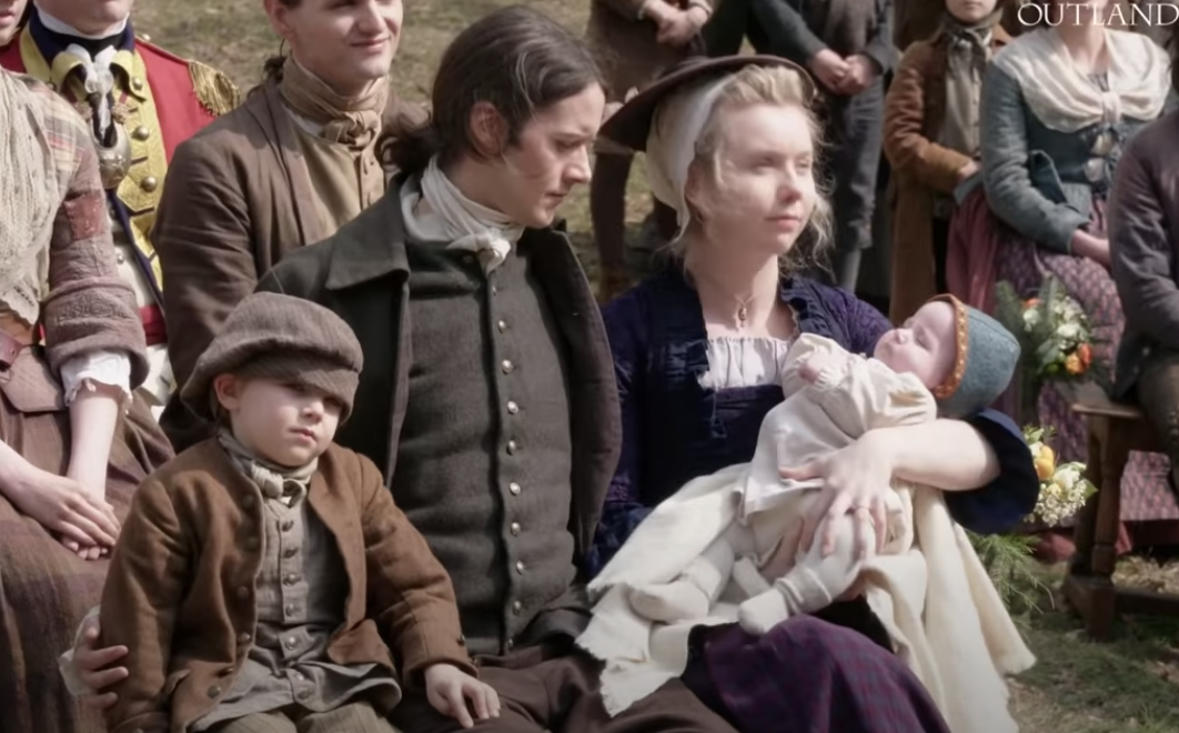 Marsali and Fergus with their two kids at Brianna's wedding