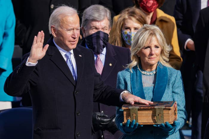 Pres. Joe Biden swearing on the bible during his inauguration