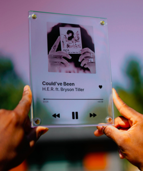 A semi transparent plaque that's printed with a Spotify song page