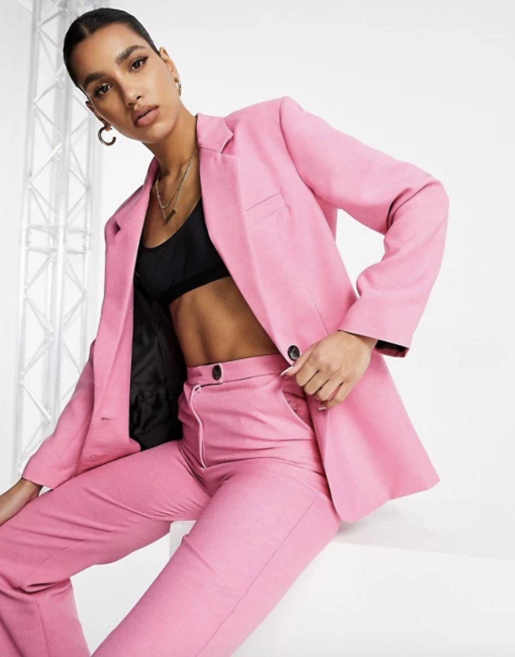 a model wearing the ASOS DESIGN slim dad suit in perfect pink