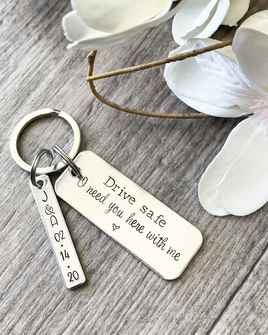 Two keychain charms with sweet messages on them