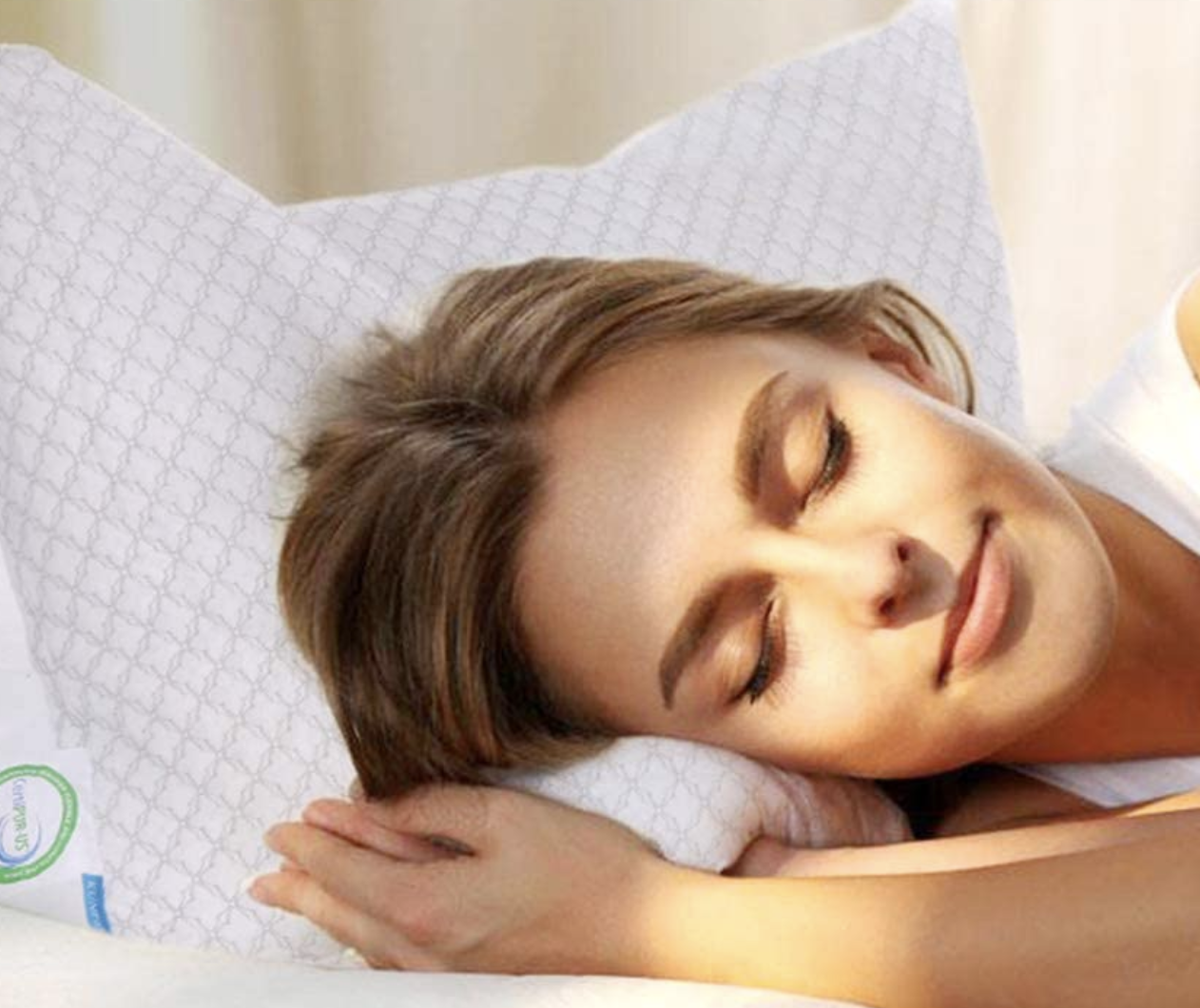 Model sleeping on a white pillow