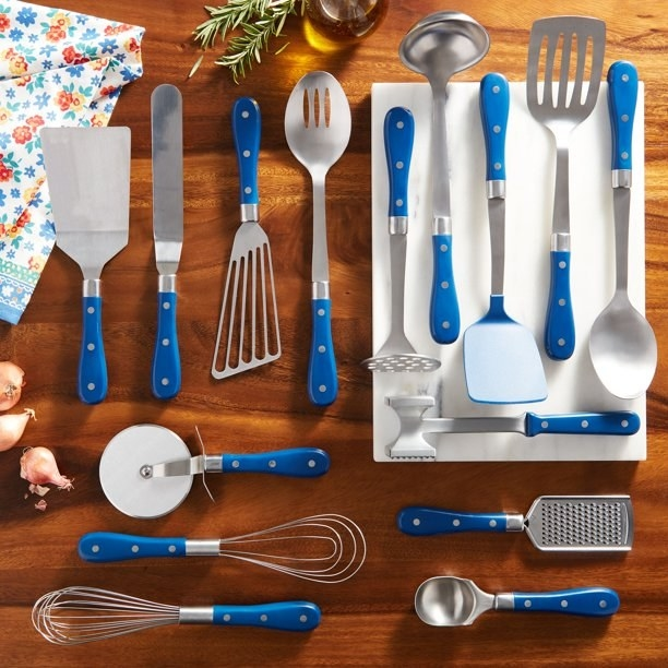 The complete blue utensil set displayed on a kitchen table