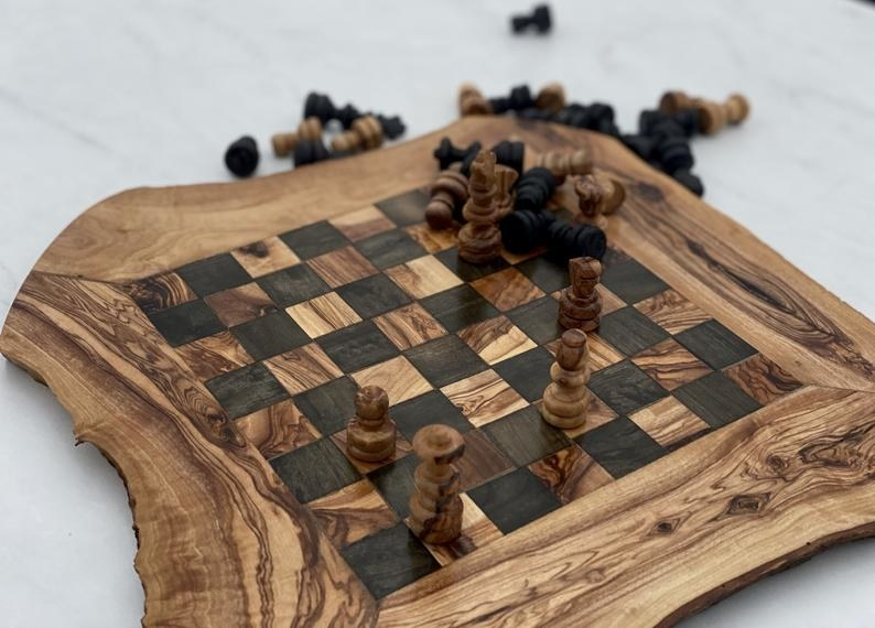 A beautiful wood chess board with its wooden pieces