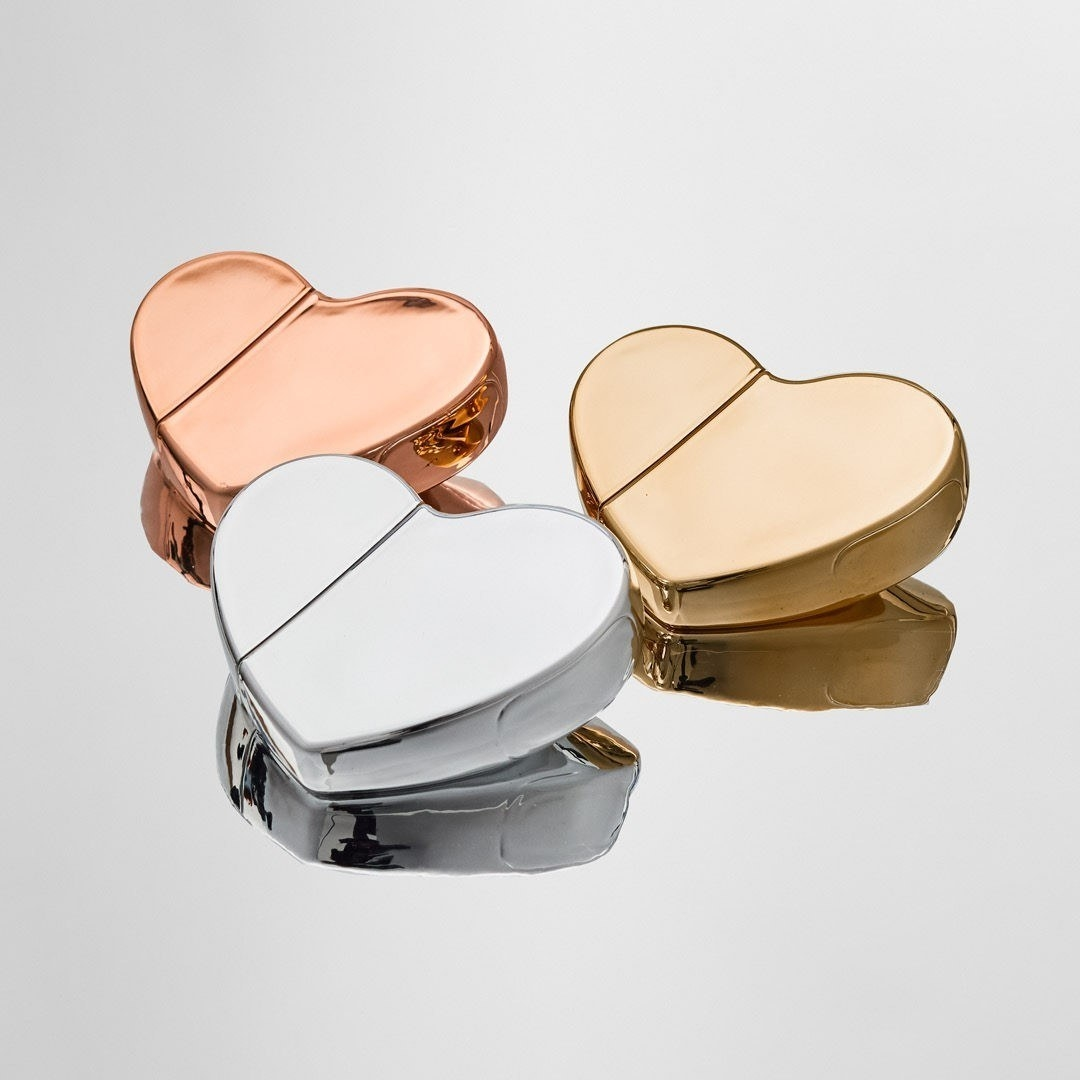a rose gold, gold, and silver perfume heart