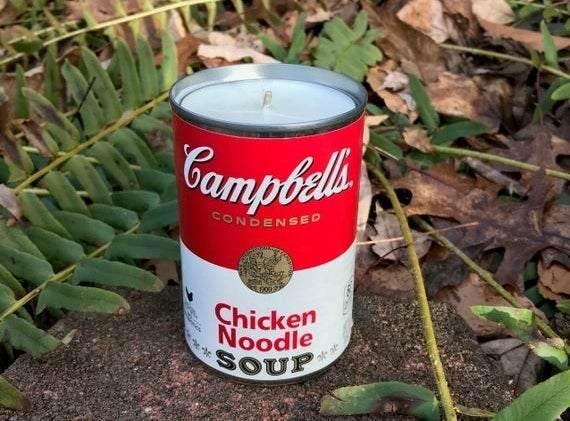 A candle made from an empty chicken noodle soup can