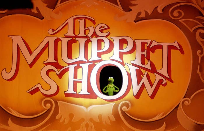 The Muppet Show sign with Kermit the Frog standing inside the O