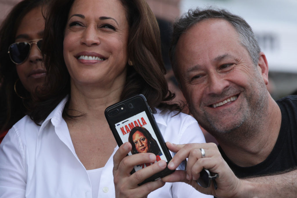 Doug Emhoff taking a selfie next to Vice President Harris