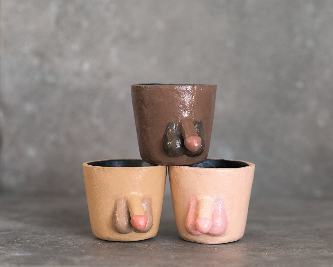 Three handmade pots, each with a penis and testicles, in different skin tone shades
