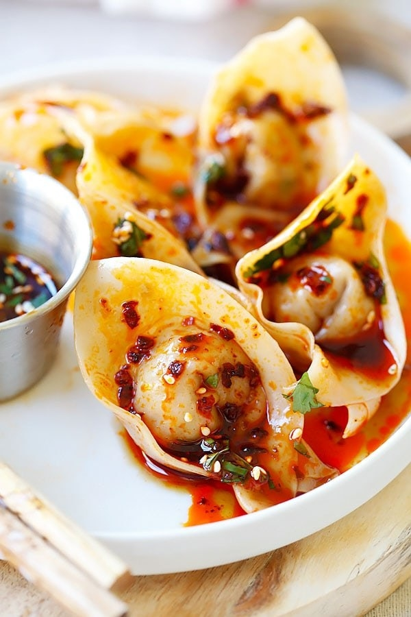 Steamed wontons in chili oil.