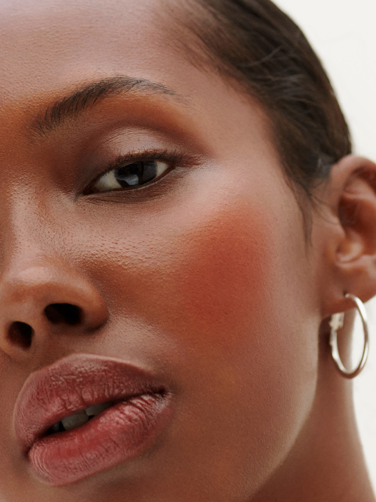 Another model with a darker skin tone with the blush on