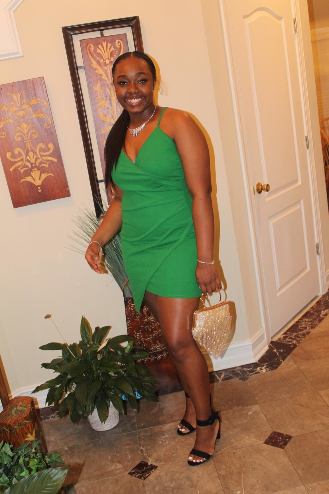 reviewer image of a customer dressed up in the green verdusa asymmetrical dress