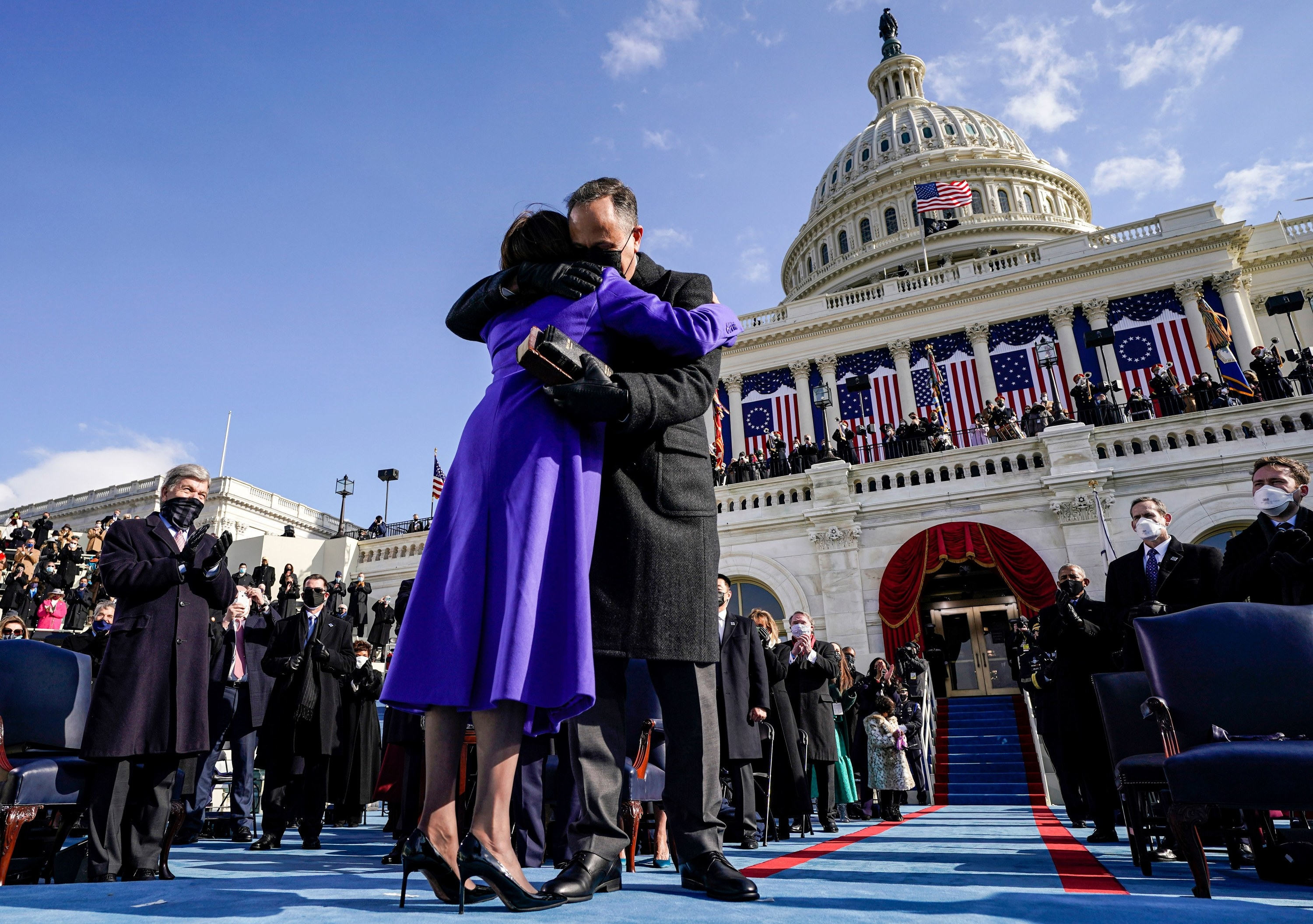 Doug Emhodd hugging his wife after she is sworn in as Vice President