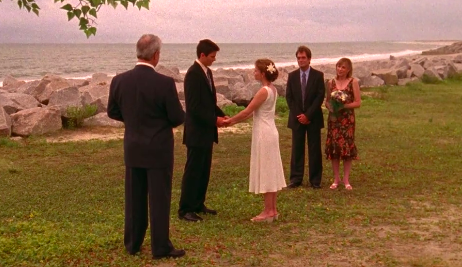 Haley and Nathan and Haley's parents at their first wedding