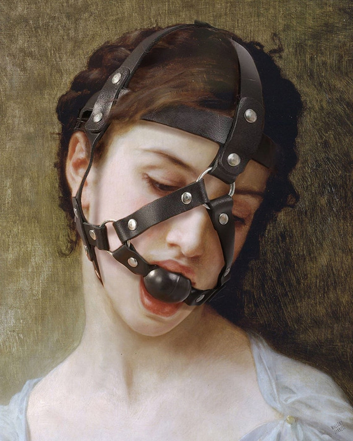 Classical style portrait of woman with added leather and metal face harness and ball gag