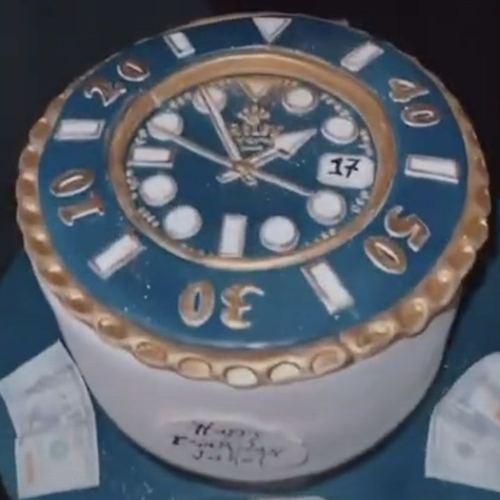 Jake shows off his Rolex cake