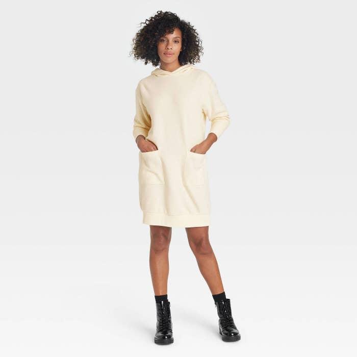 Model in hooded long sleeve dress