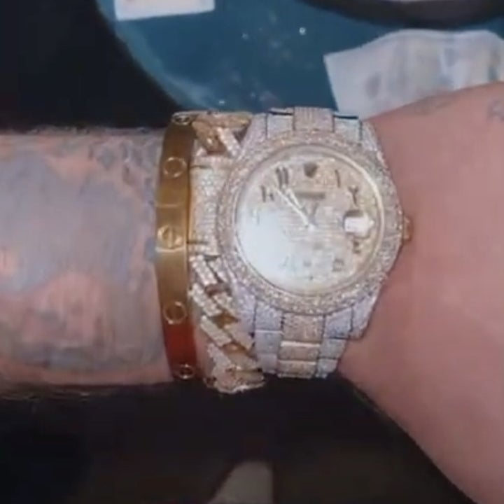Jake shows off his Rolex watch
