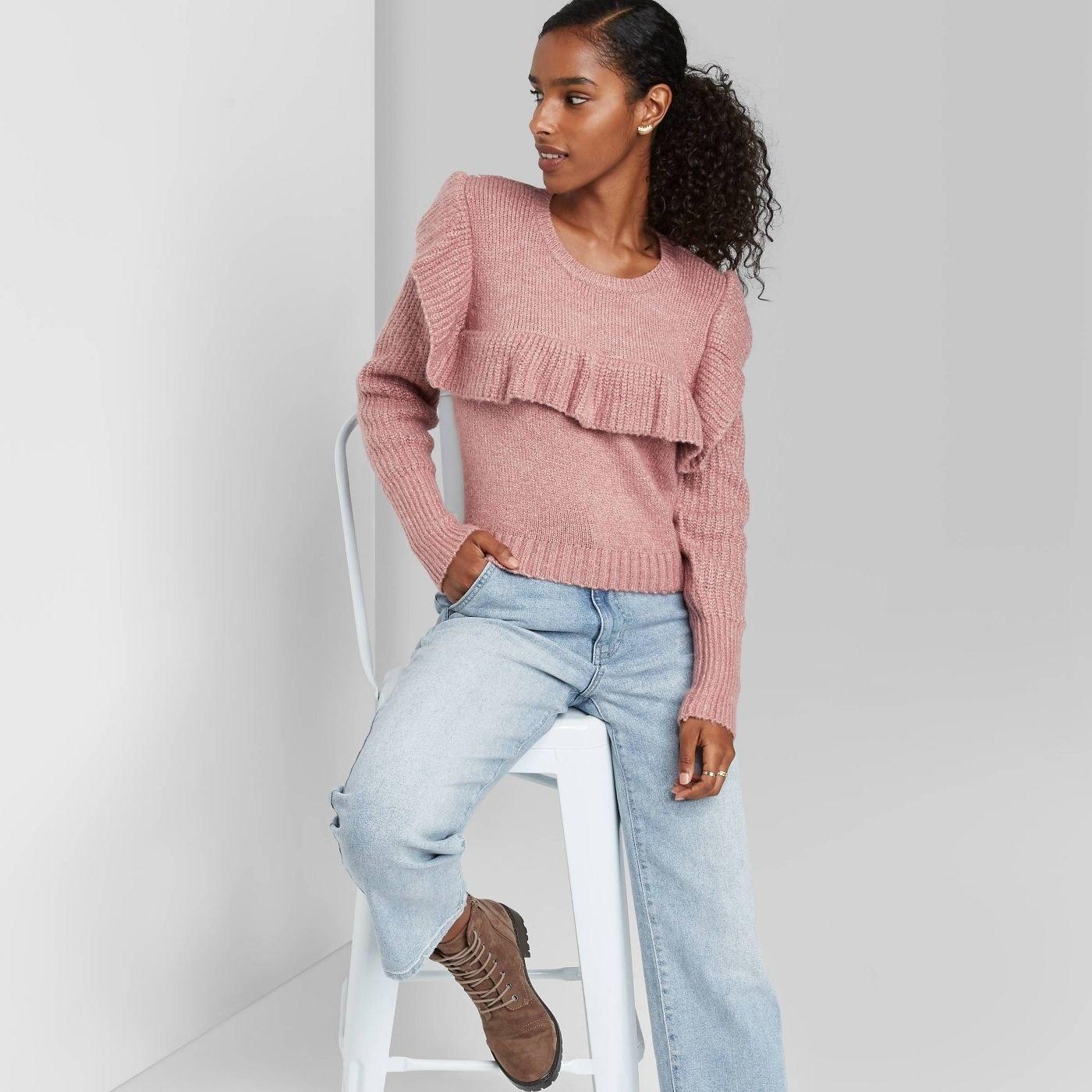Model in crewneck ruffle sweater