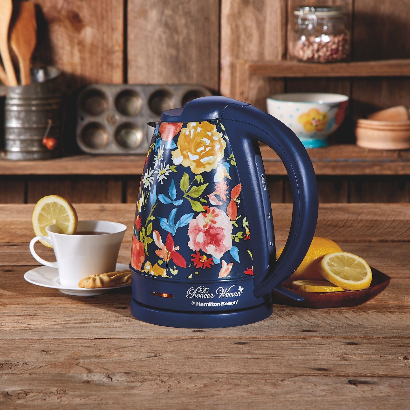 The electric kettle with a blue floral pattern in a kitchen